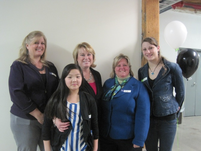Lisa Sutton (third from left) with her daughter (second from left) and Open House helpers