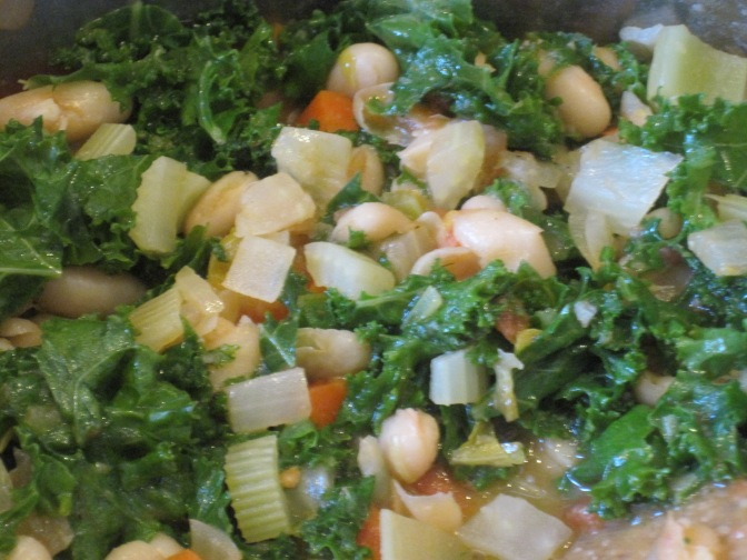 vegetables, tomatoes, beans, broth in the pot to simmer
